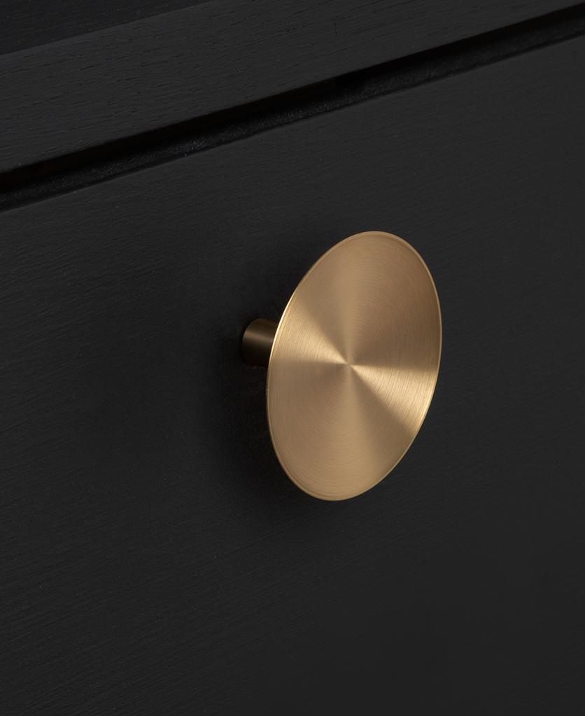 large rococo gold knob on black drawer