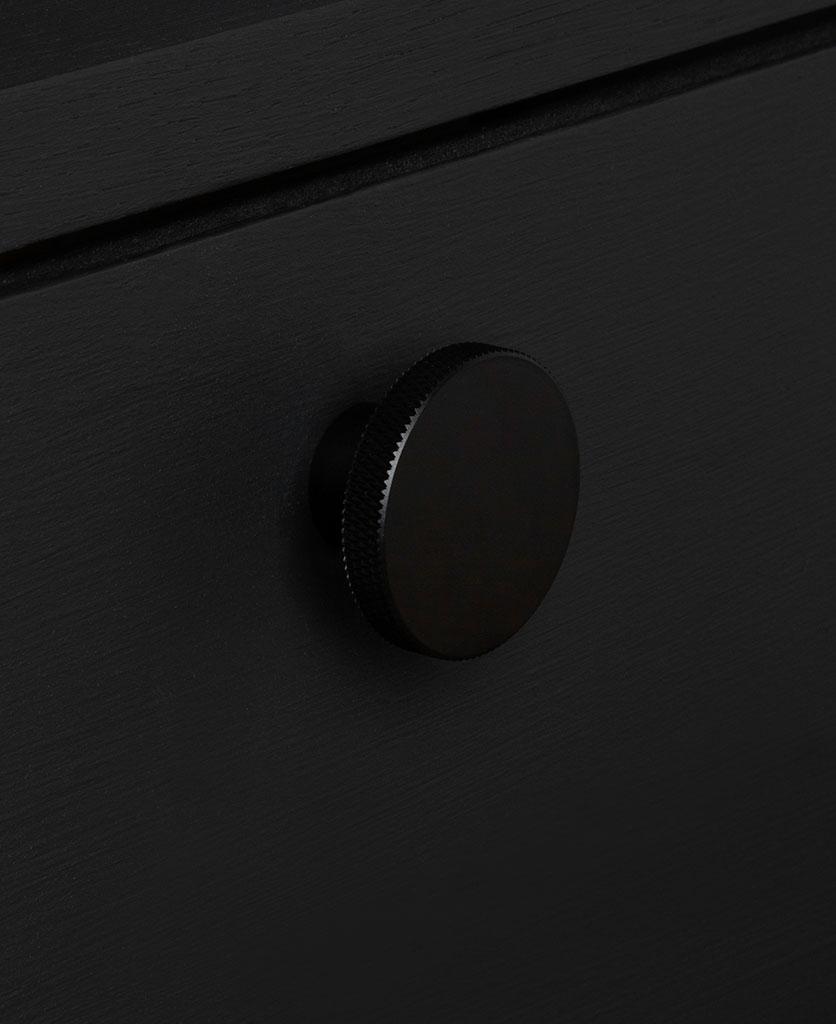 modernist large black knob on black drawer