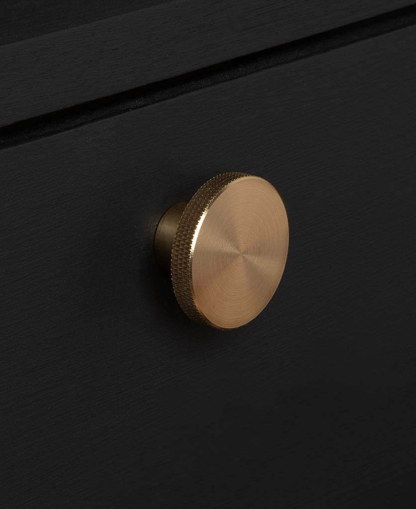 modernist large gold knob on black drawer