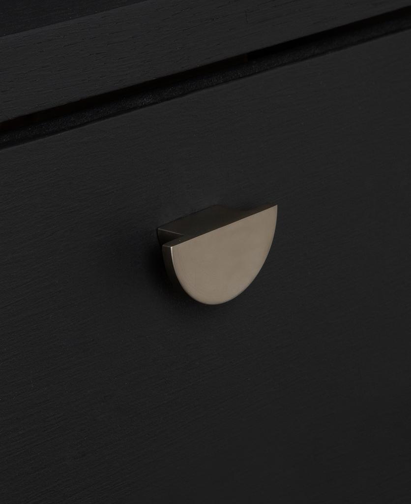 nouveau silver knob on black drawer