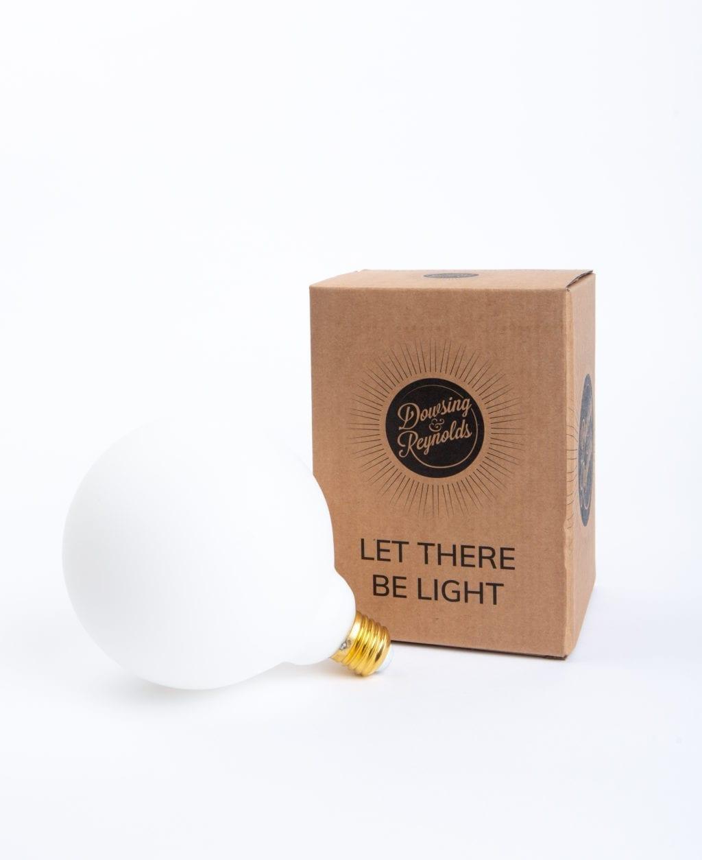 Aurora globe light bulb with cardboard box against white background