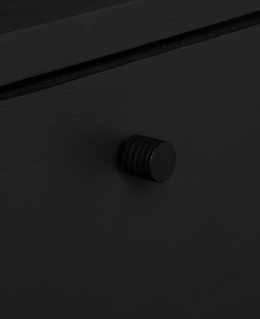 small avant garde black knob on black drawer