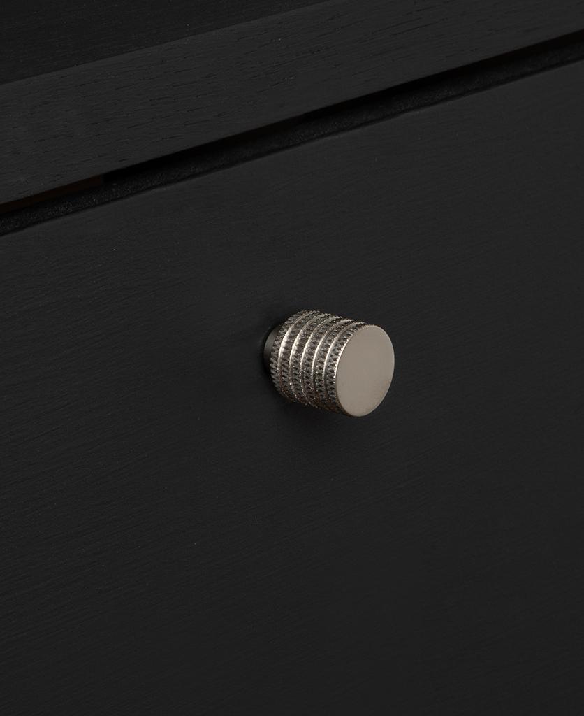 small avant garde silver knob on black drawer