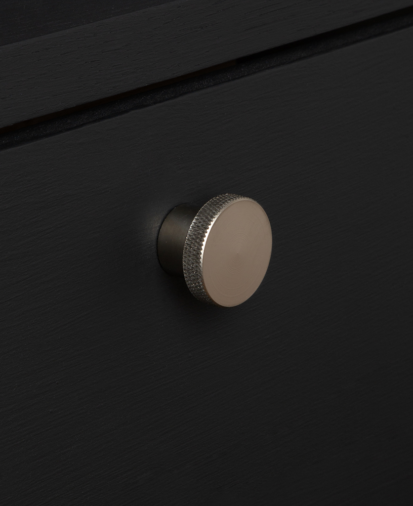 small modernist silver knob on black drawer