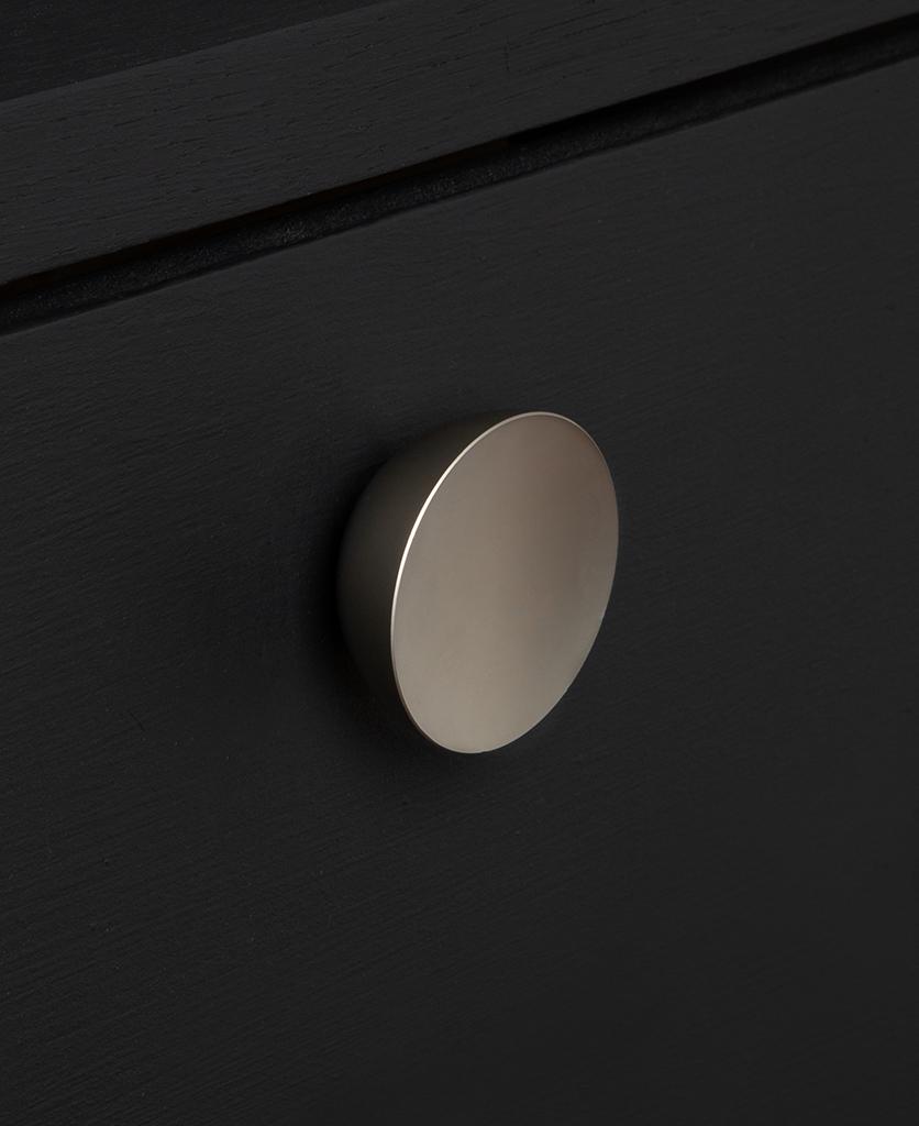 surrealist knob silver on black drawer