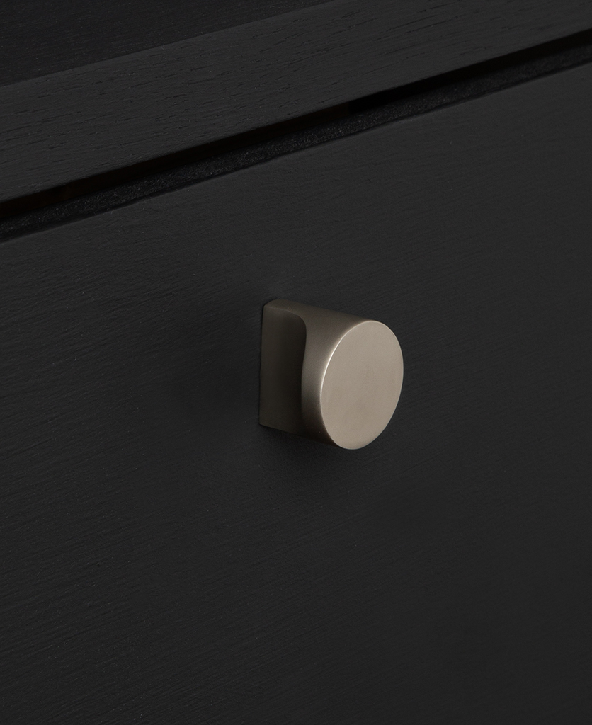 abstract knob silver on black drawer