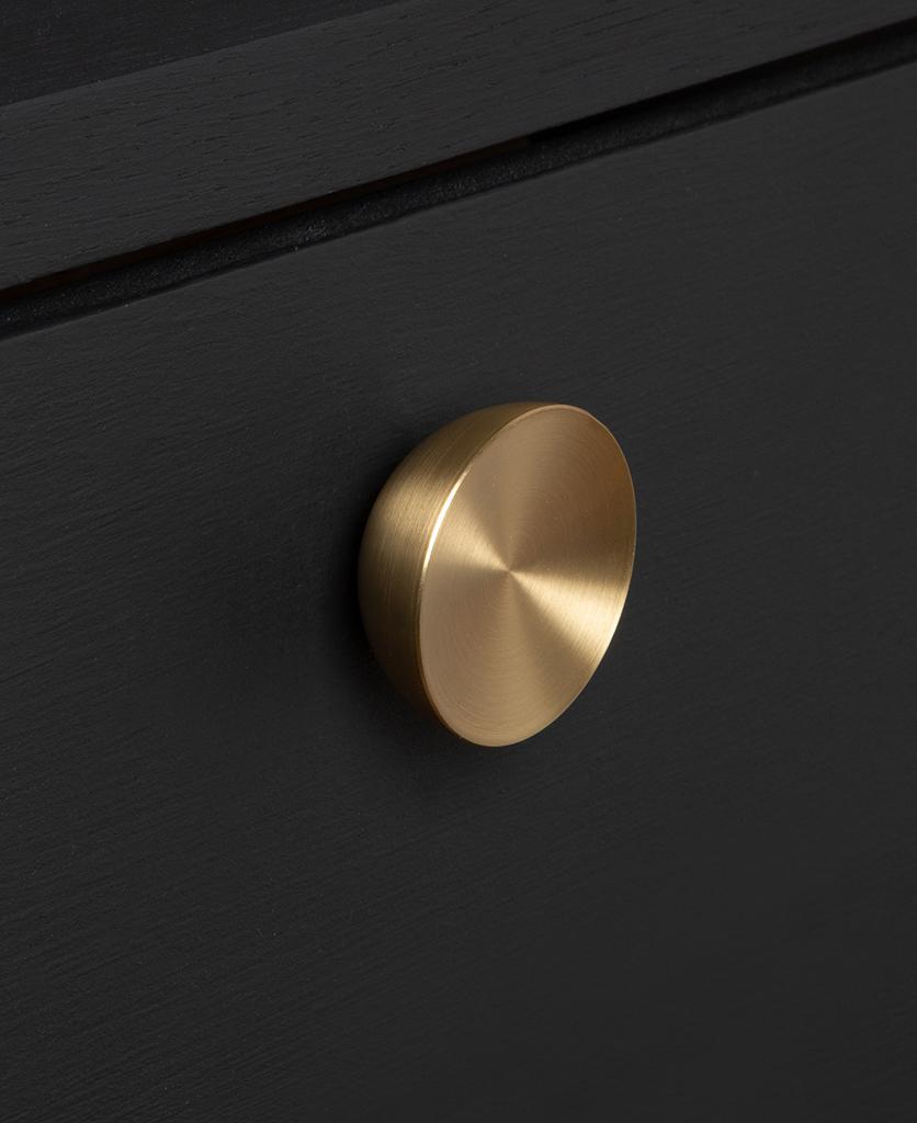 surrealist knob gold on black drawer