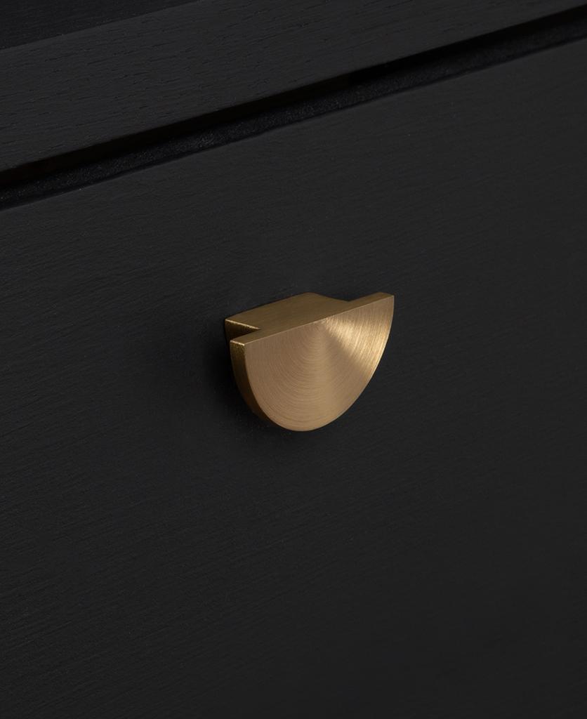 nouveau knob gold on black drawer