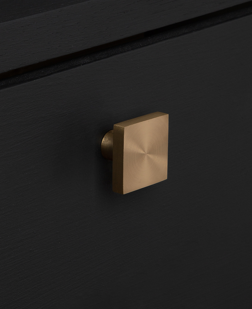 expressionist knob gold on black drawer
