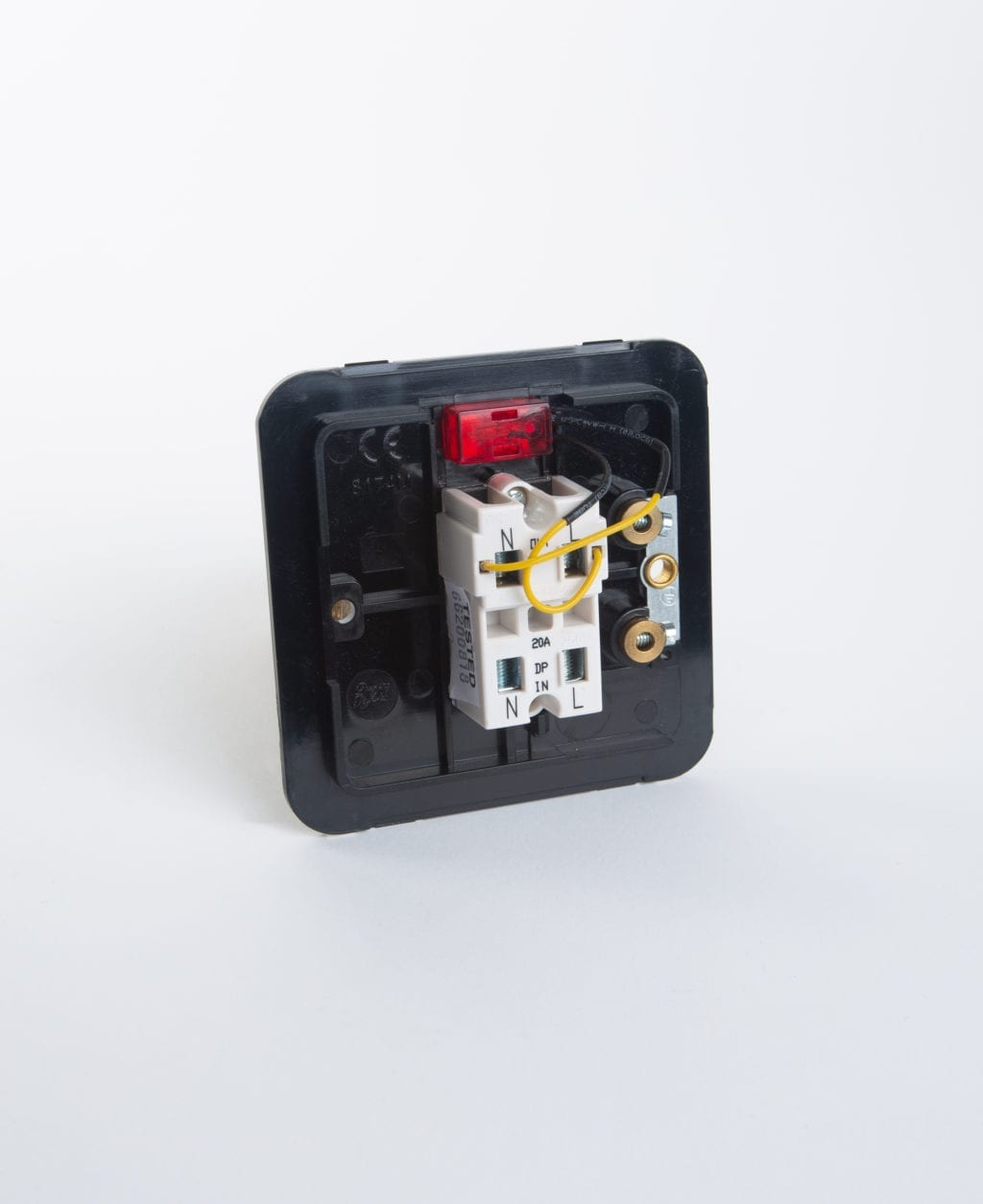 20a double pole switch back plate against white background