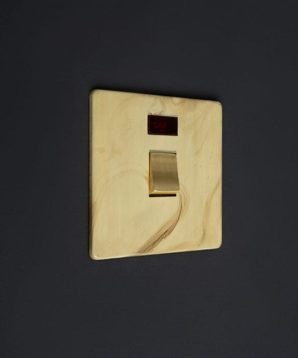 smoked gold and gold 20A DP switch against black background