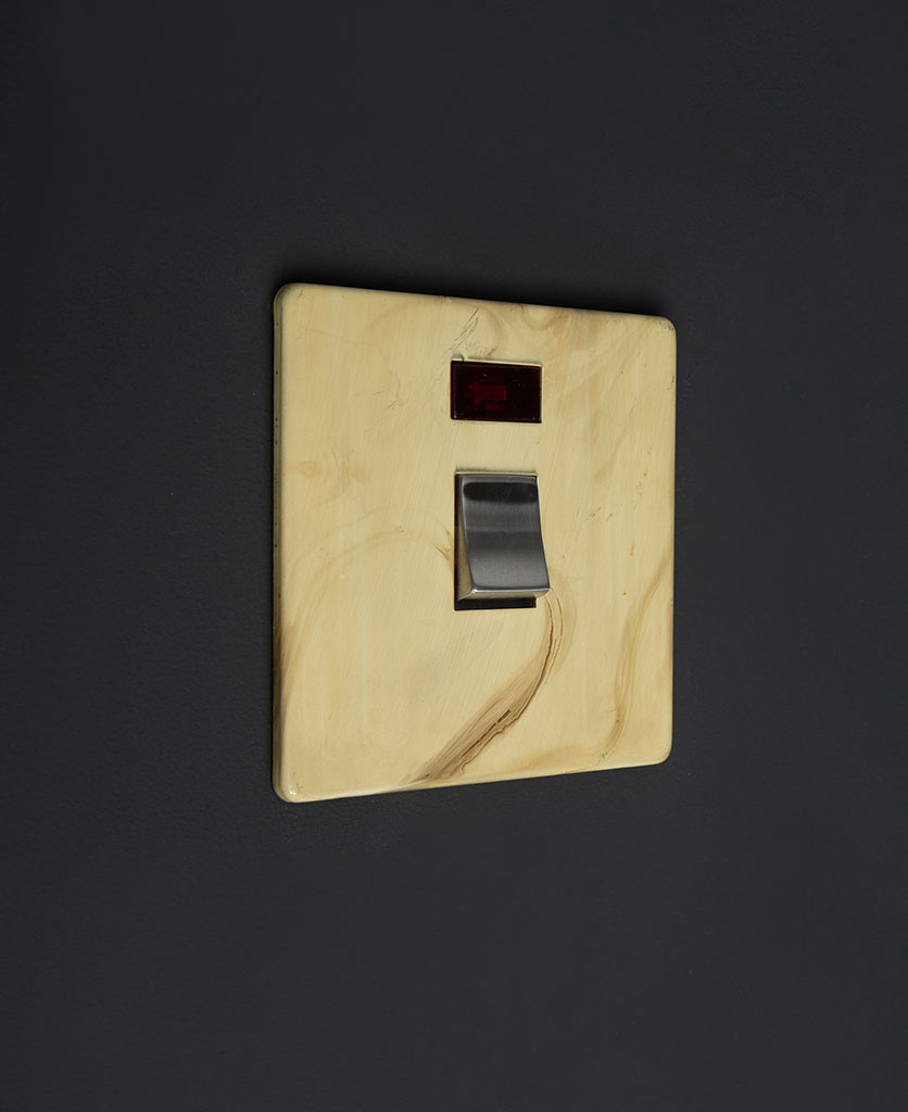 smoked gold and silver 20A DP switch against black background