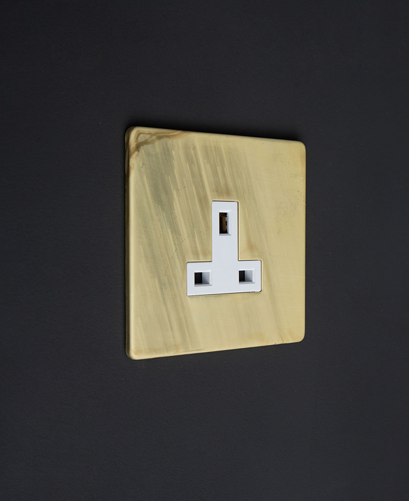 13A unswitched metal plug socket smoked gold with white inserts on a black background