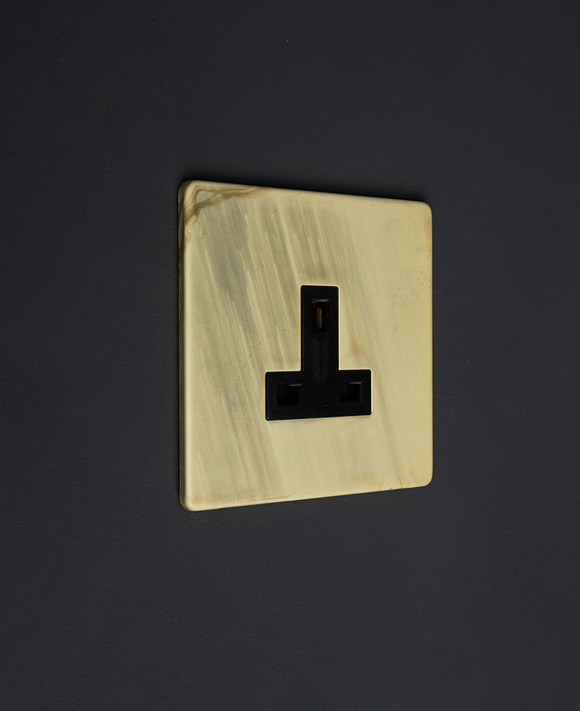 13A unswitched metal plug socket smoked gold with black inserts on a black background