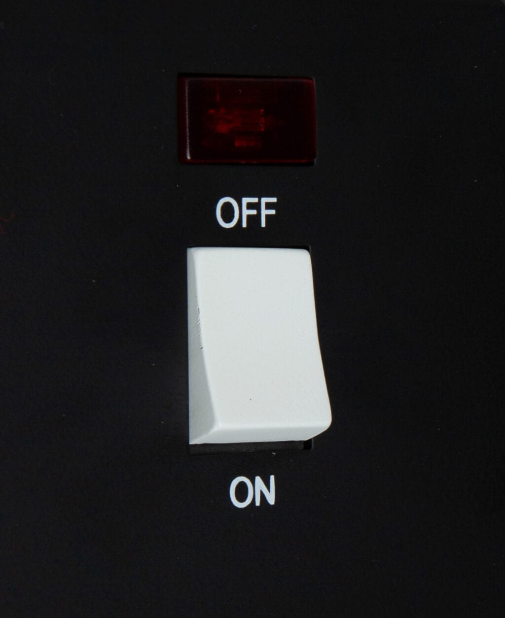 black and white 20A DP switch close up