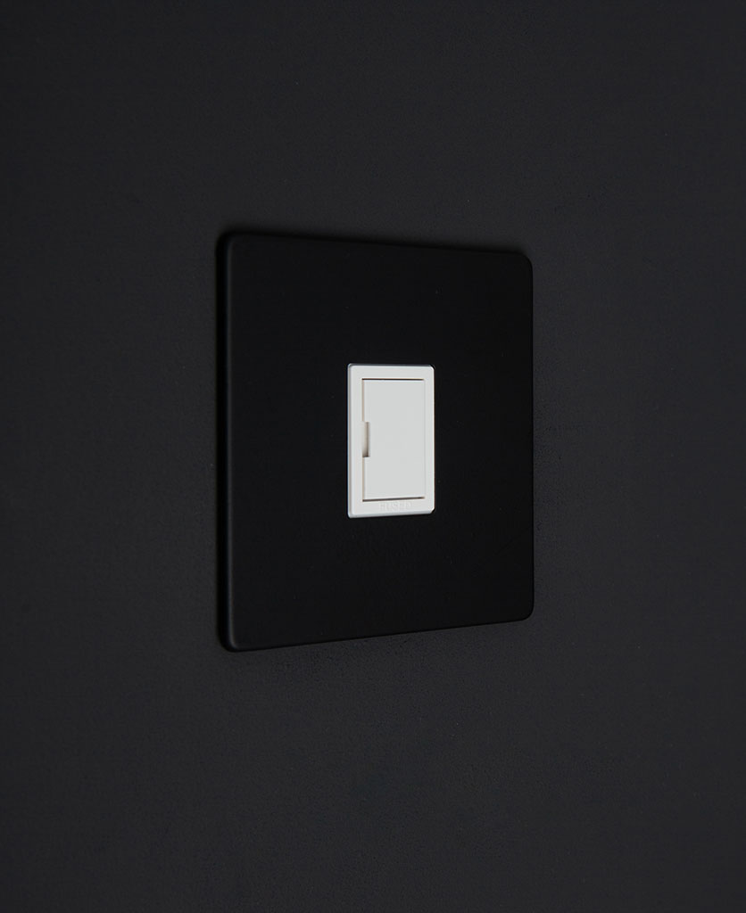 black and white fused spur switch against black background