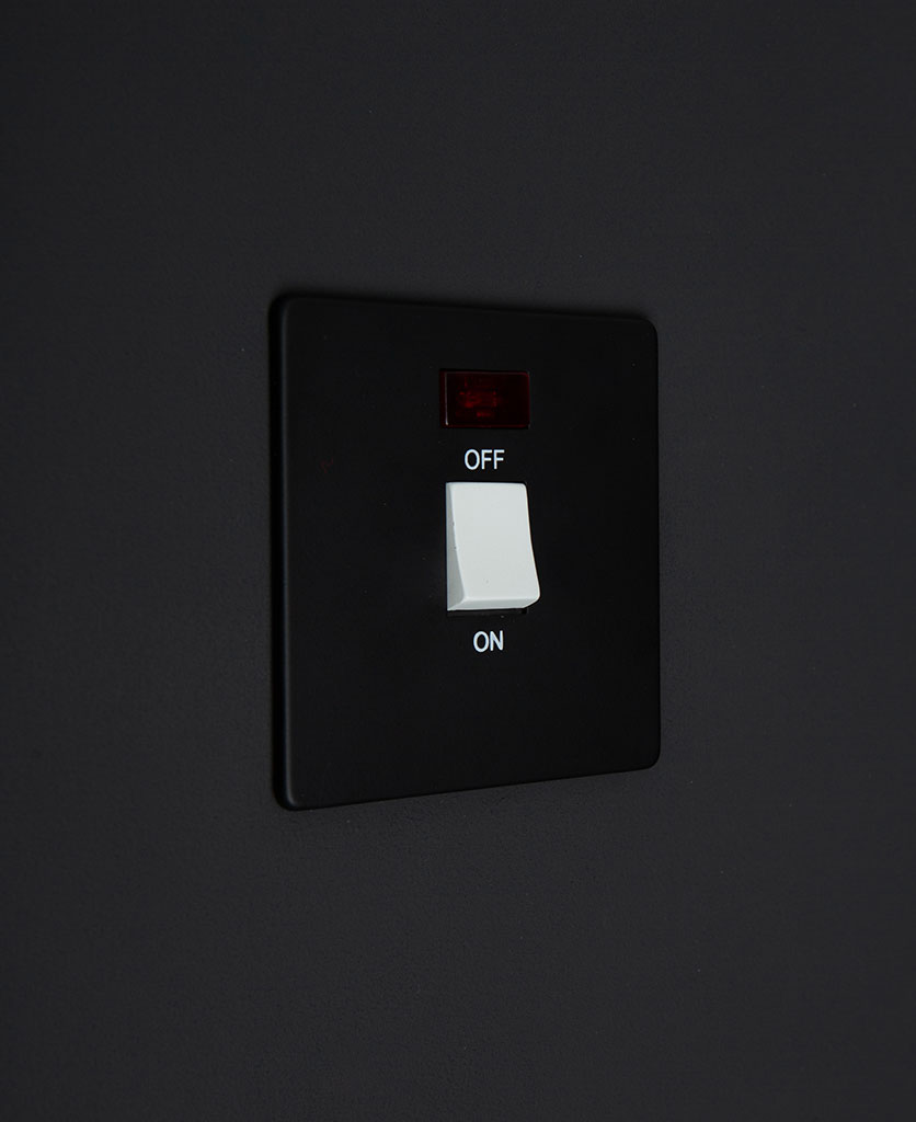 black and white 20A DP switch against black background