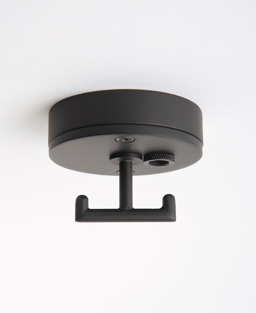 black ceiling rose with t shaped hook against white background