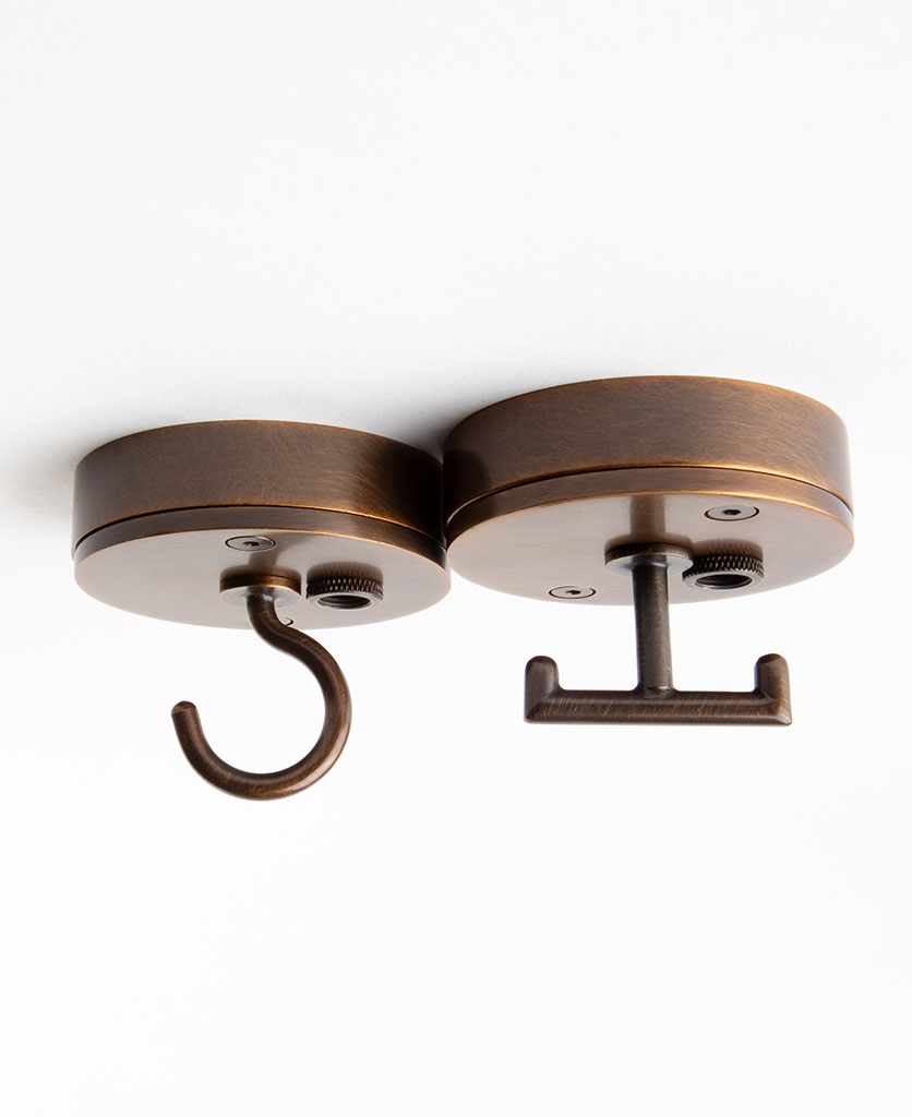 antique brass ceiling rose light fitting with hook against white background