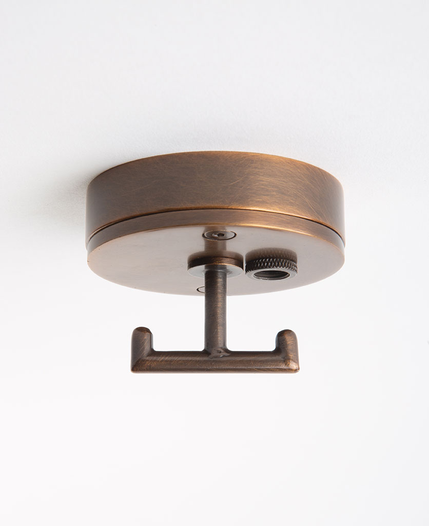 brewer's brass ceiling rose with t shaped hook against white background