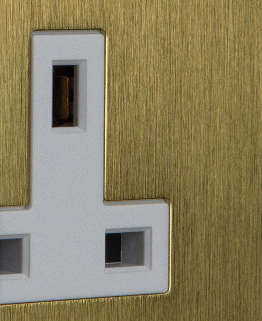 gold & white double unswitched socket closeup