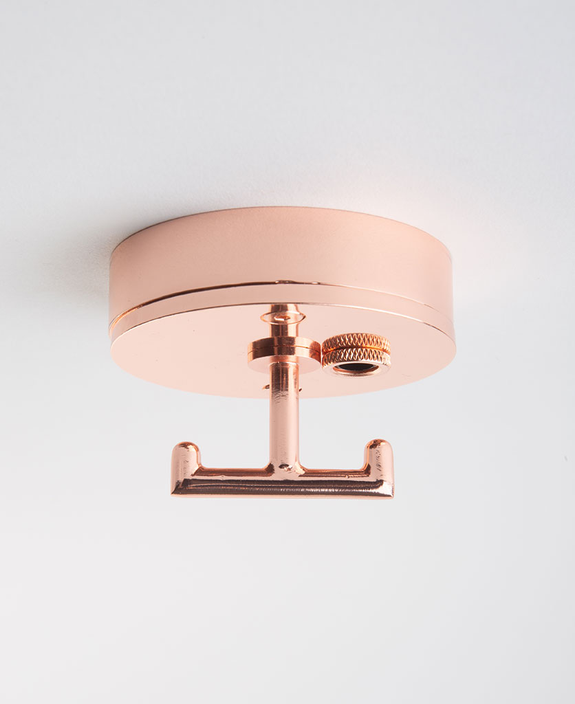 polished copper ceiling rose with t shaped hook against white background