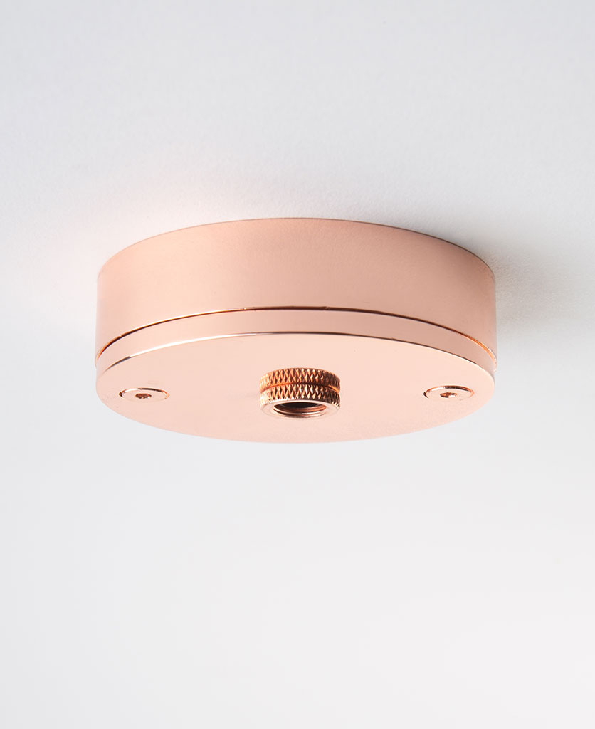 small copper ceiling rose against white background
