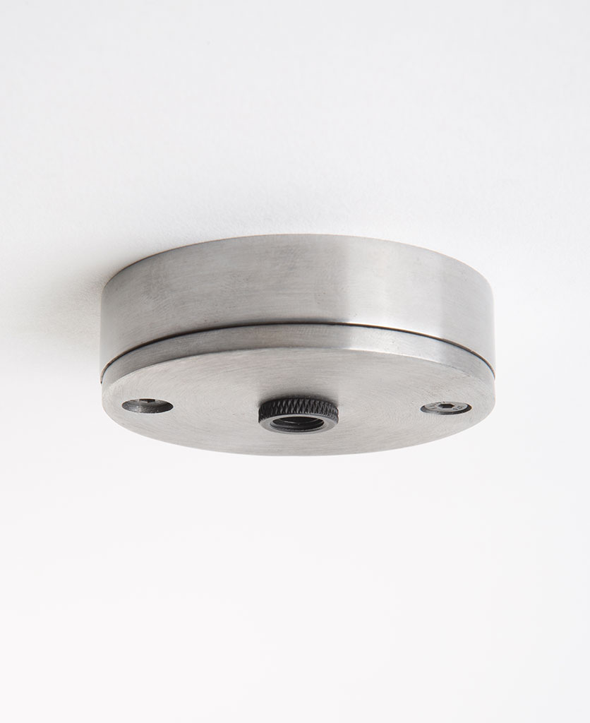 steel ceiling rose against white background