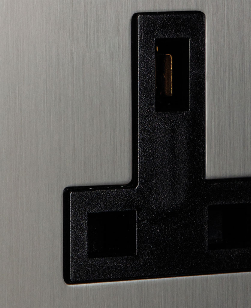closeup of silver & black unswitched plug socket