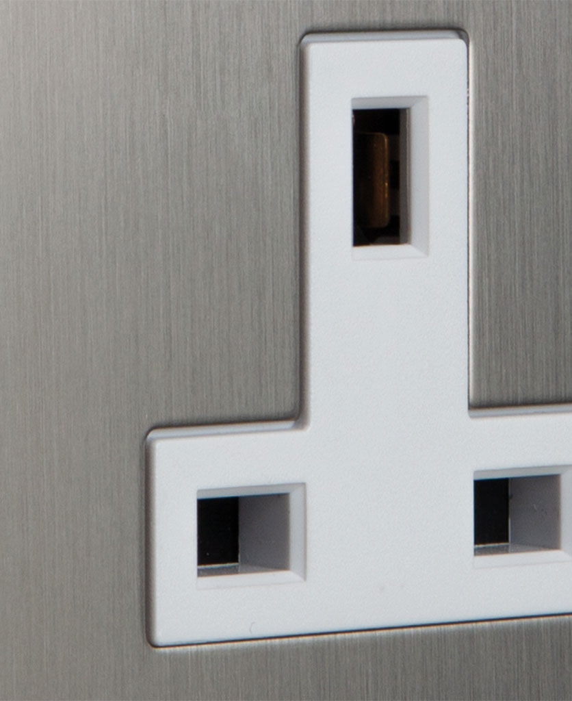 closeup of silver & white unswitched plug socket