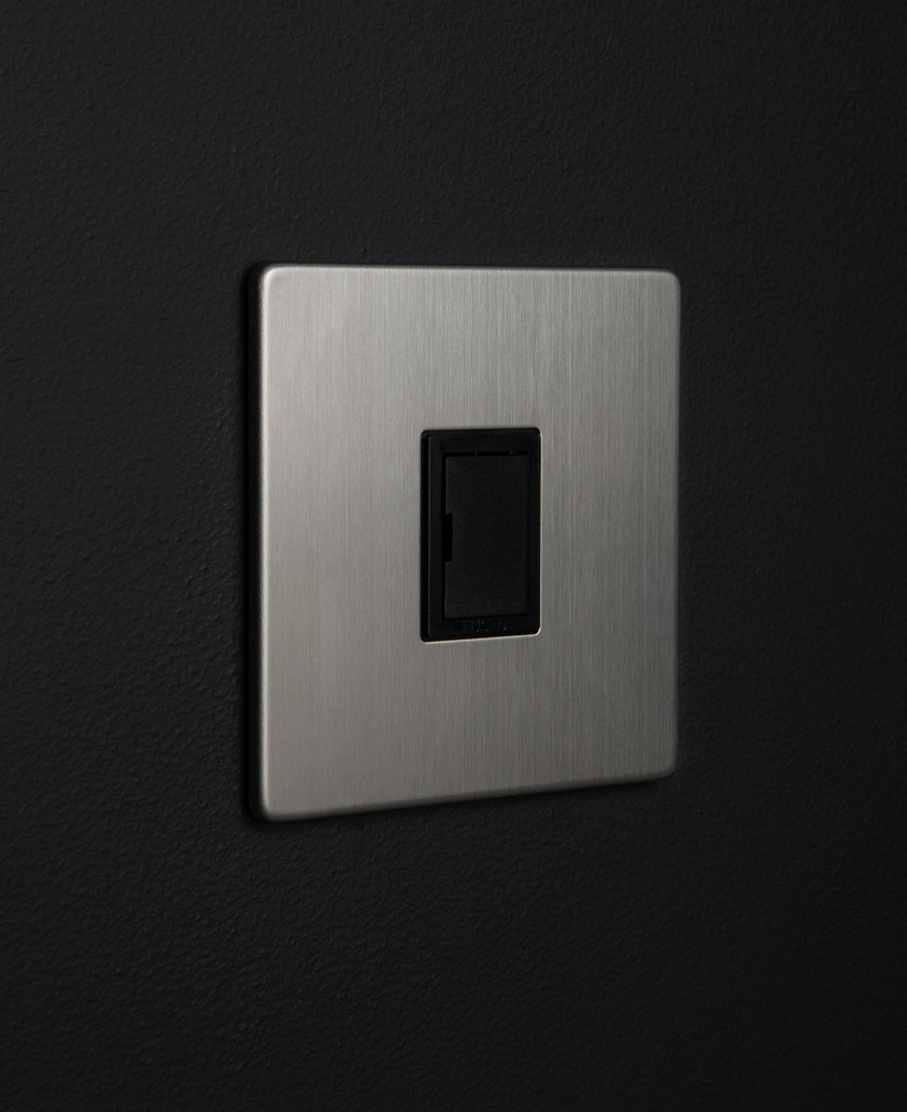 silver unswitched fuse with black detail against black background