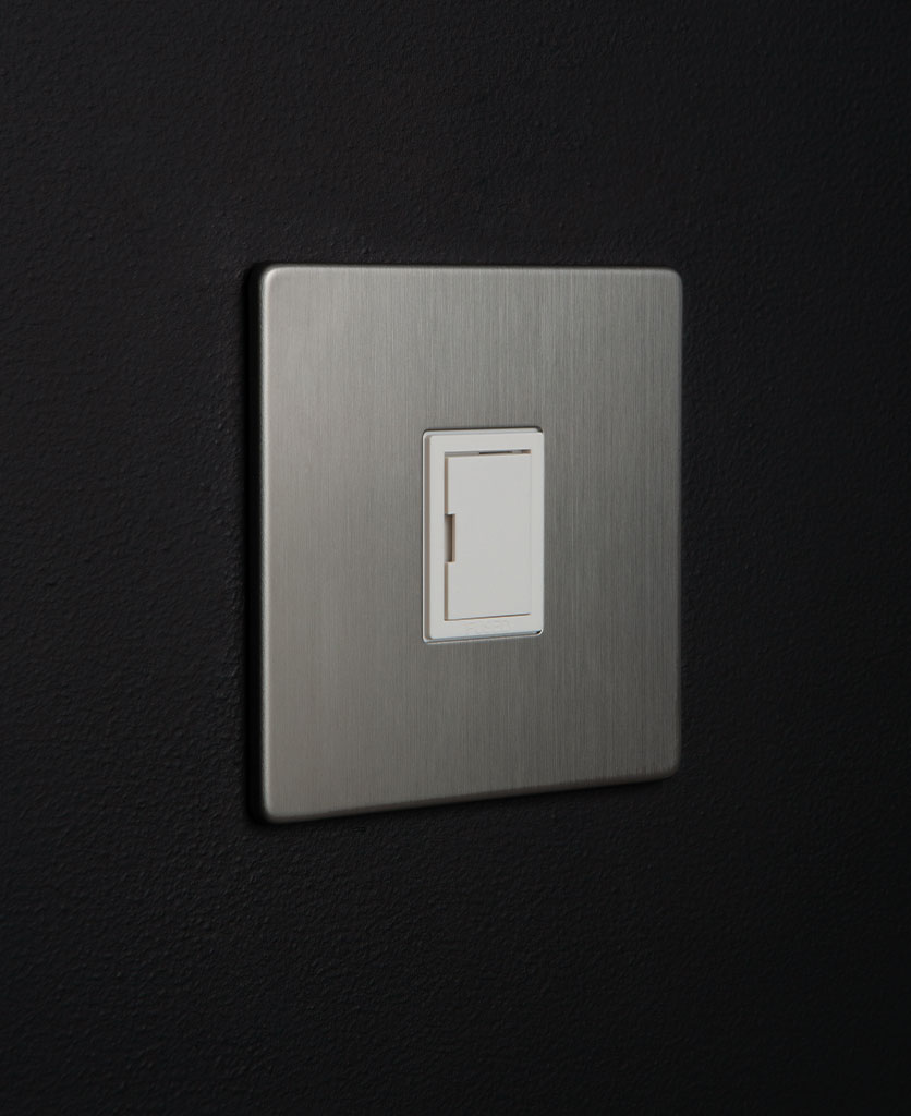 silver unswitched fuse with white detail against black background
