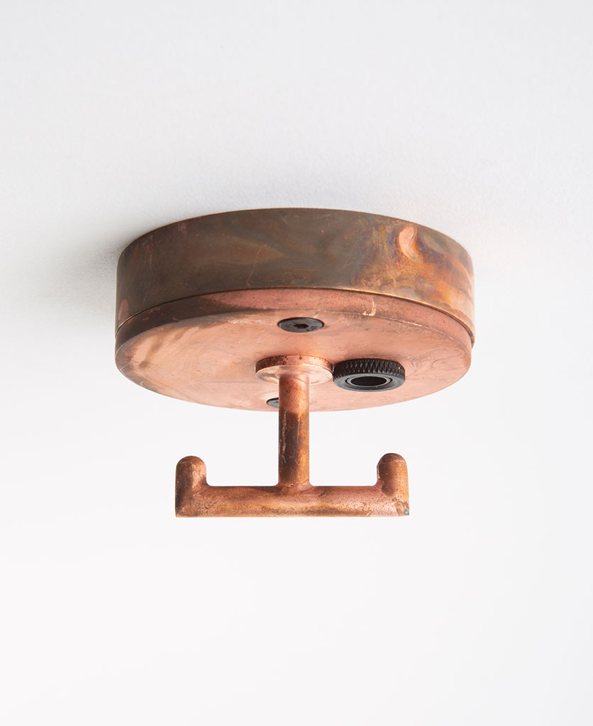 Small copper ceiling rose with t shaped hook against white background