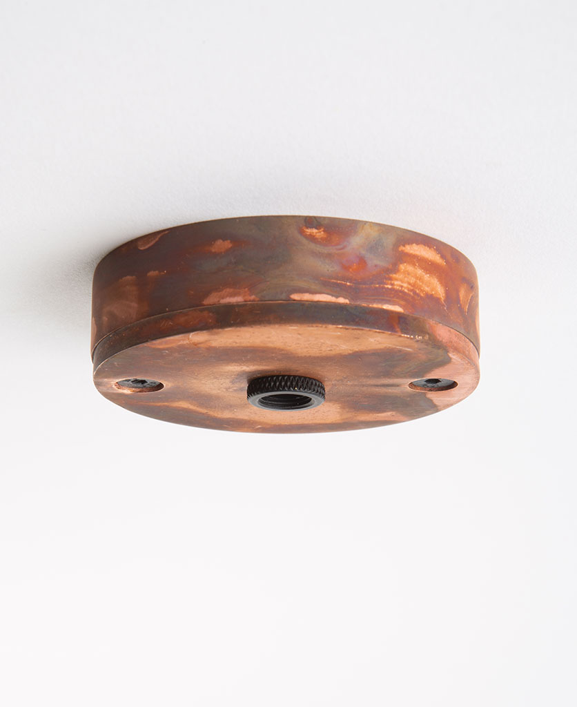 tarnished copper small ceiling roses against white background
