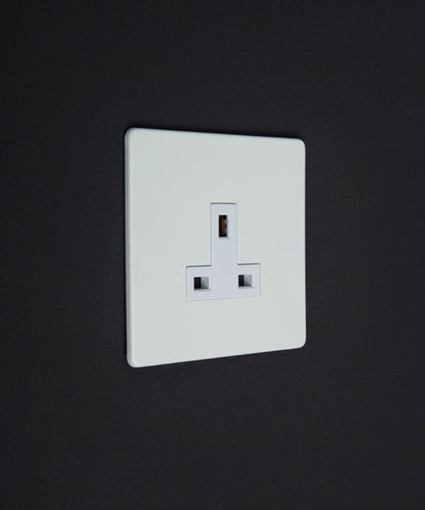 white wall plug socket with white insert against a black wall