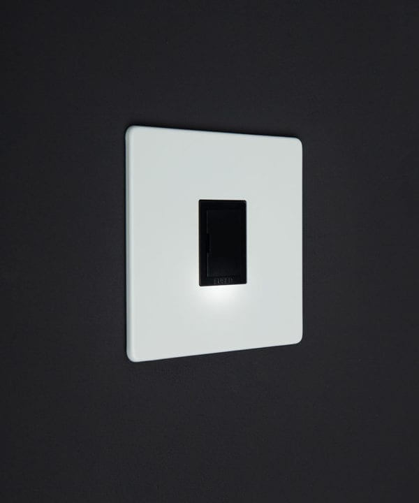 white and black unswitched fuse spur switch against black background