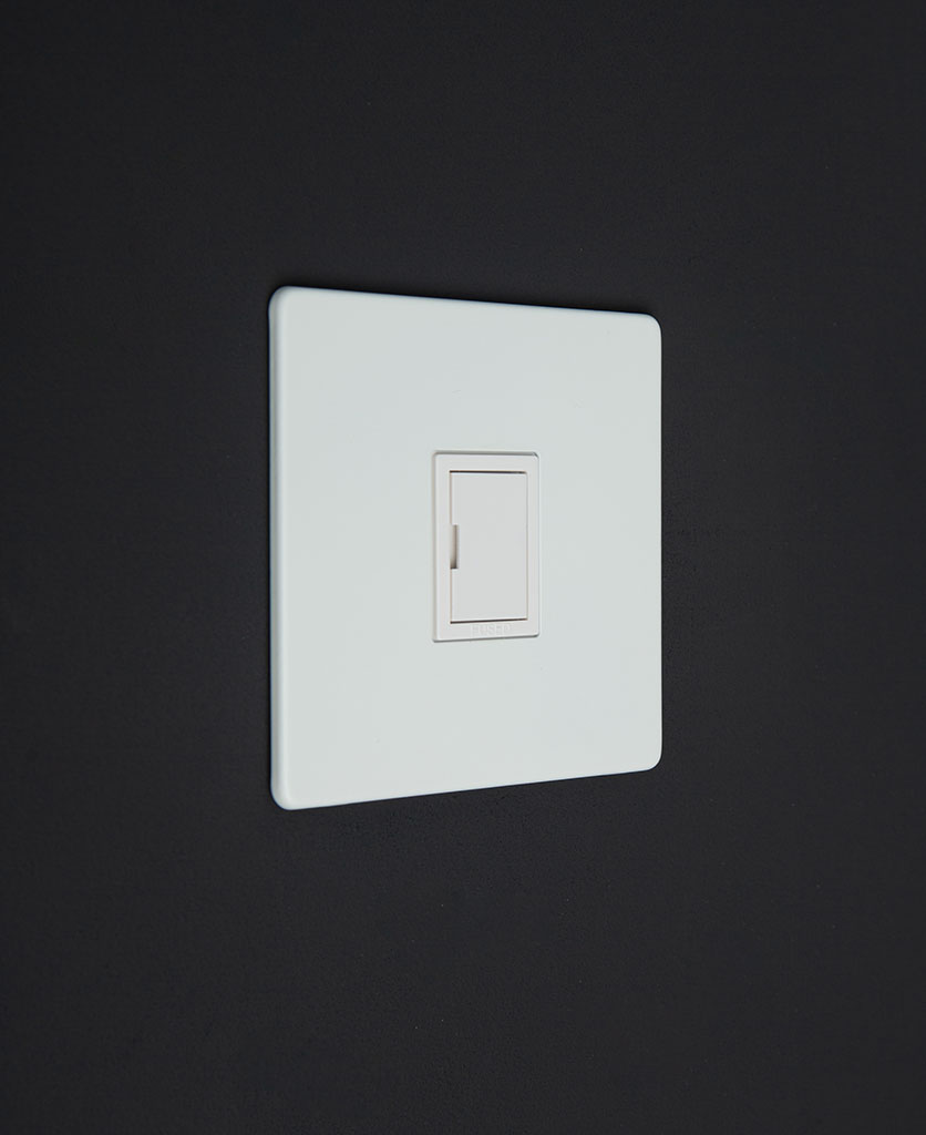 white unswitched fuse spur switch against black background
