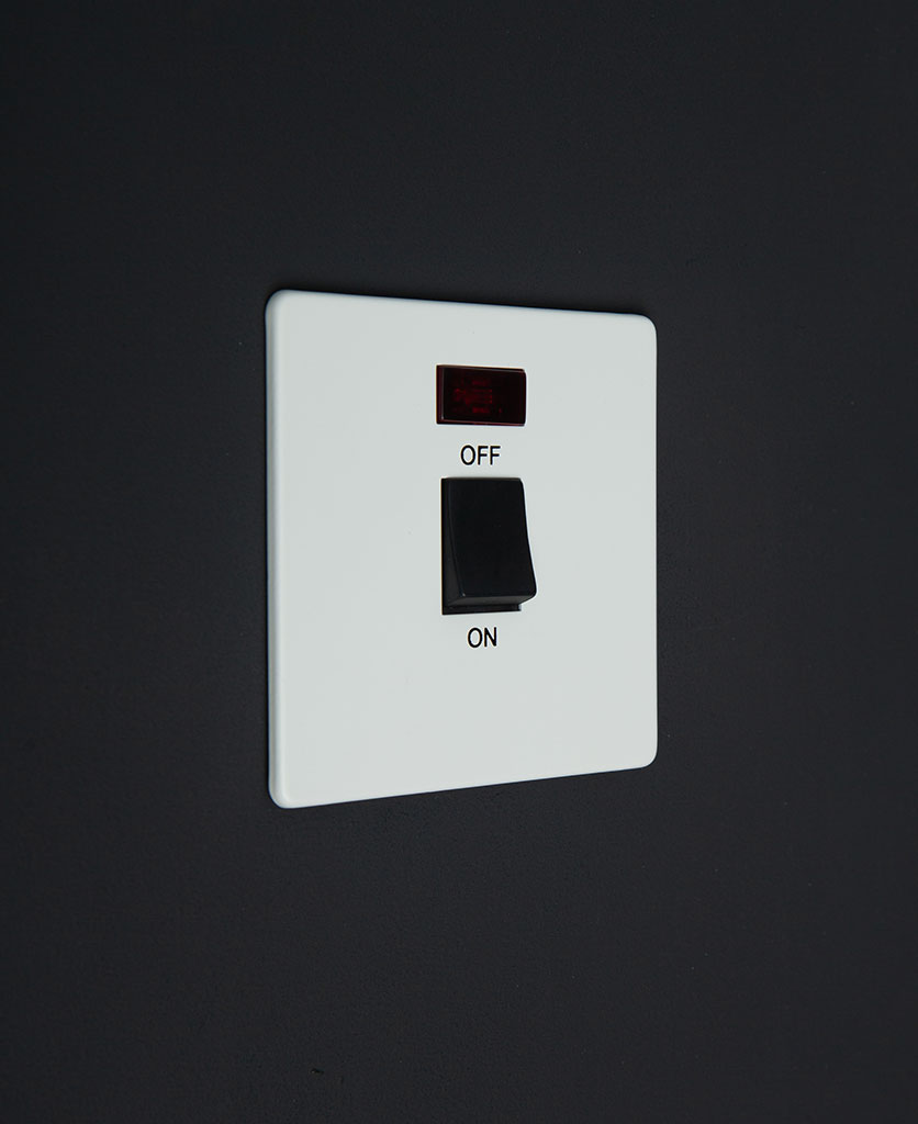 white and black 20A DP switch against black background