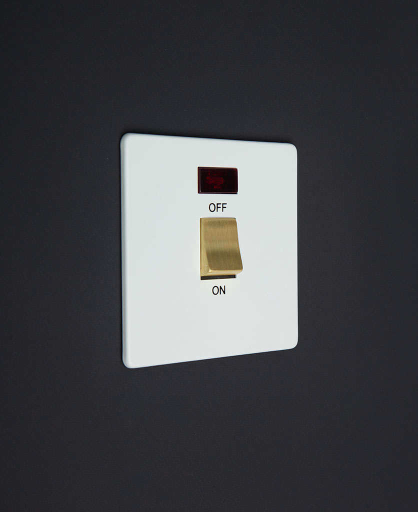 white and gold 20A DP switch against black background