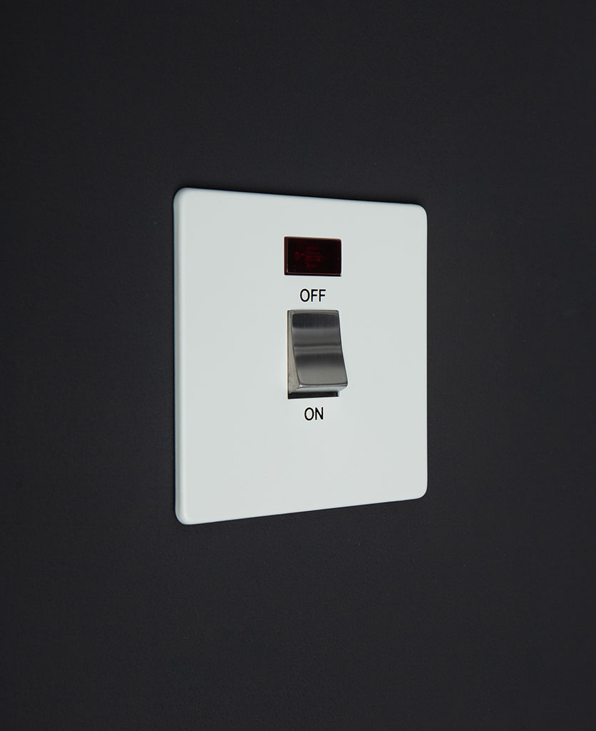 white and silver 20A DP switch against black background