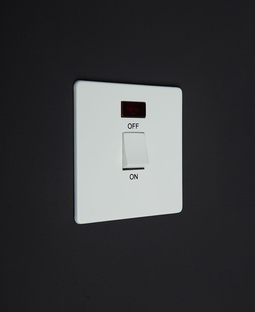 white 20A DP switch against black background