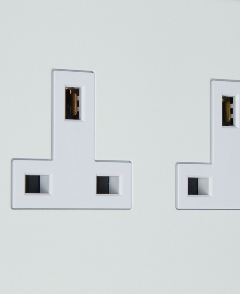 white double unswitched plug socket close up