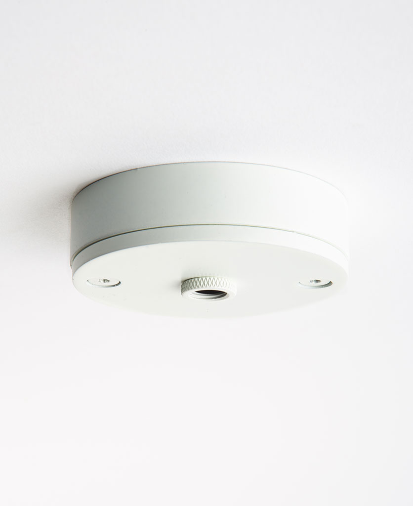 small white ceiling rose against white background