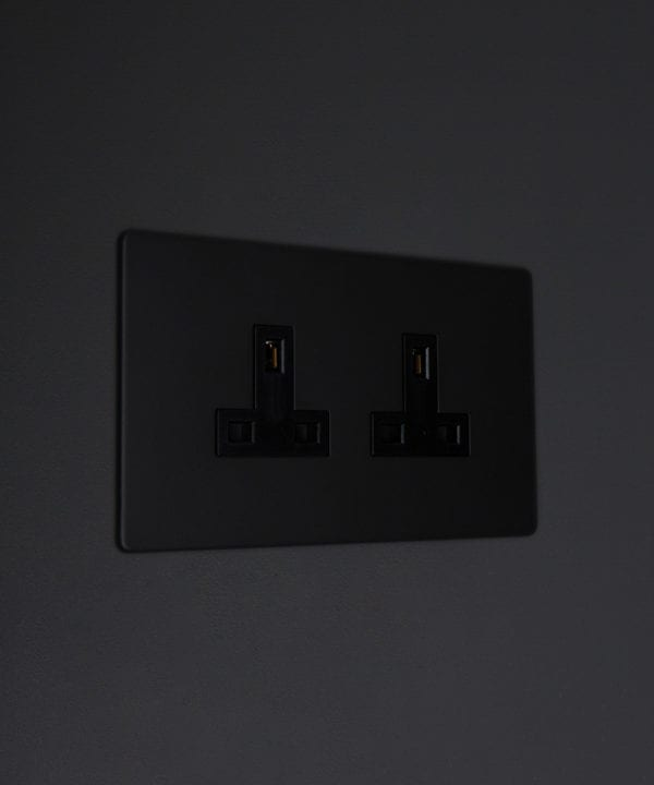 black double unswitched 2g plug socket on black background