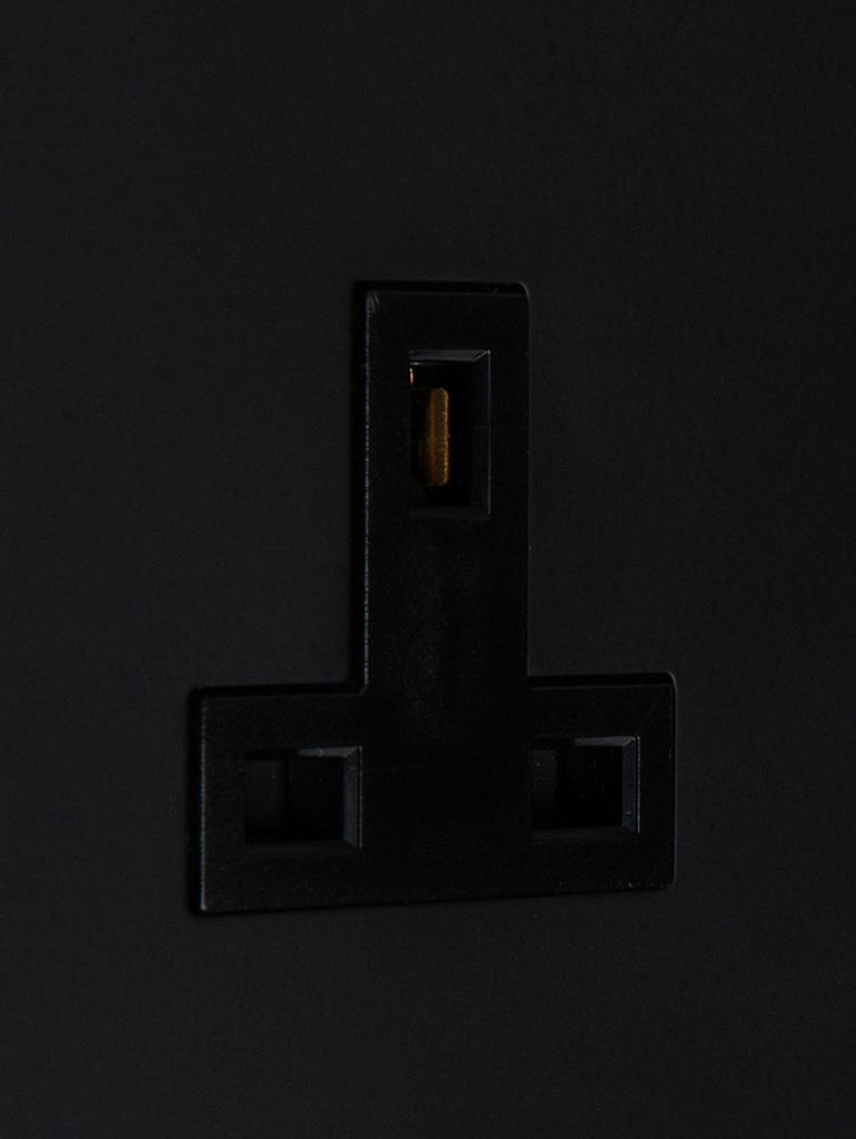 black unswitched single 1g plug socket close up