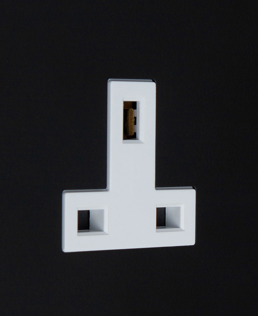 black and white unswitched single 1g plug socket close up