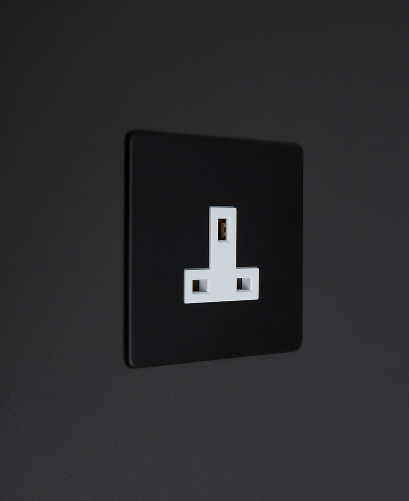 black and white unswitched single 1g plug socket