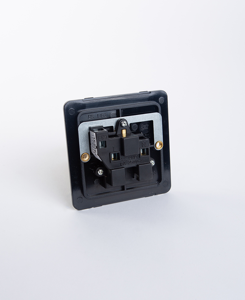 single unswitched wall socket back plate against white background