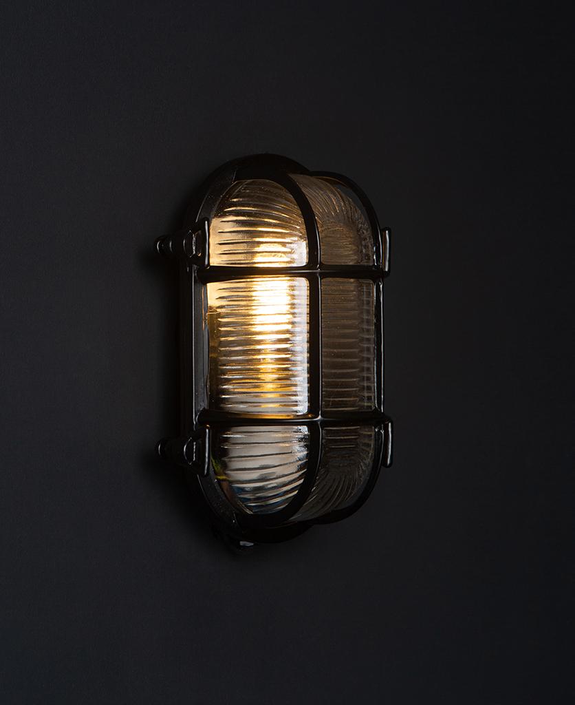 steve lit black bulkhead light with wingnuts against black background