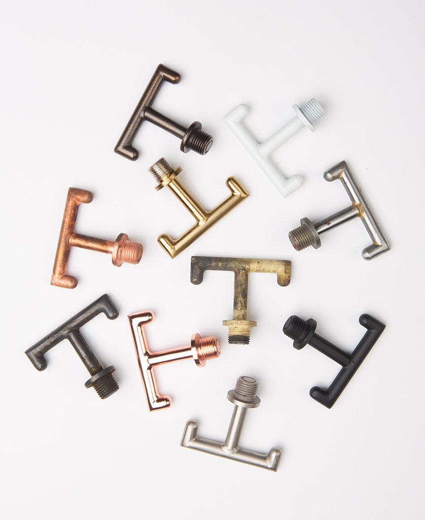 metal t shaped hooks against wjite background